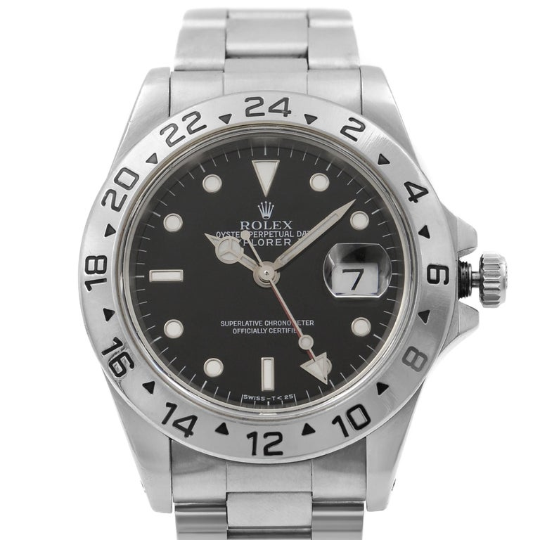 This pre-owned Rolex Explorer II 16570 is a beautiful men's timepiece that is powered by mechanical (automatic) movement which is cased in a stainless steel case. It has a round shape face, dual time dial and has hand sticks & dots style markers. It