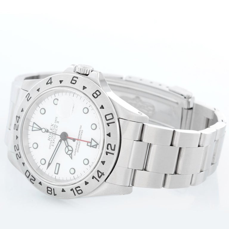 Rolex Explorer II Men's Stainless Steel Watch 16570 - Automatic winding, 31 jewels, Quickset, sapphire crystal, dual time. Stainless steel case (40mm diameter). White dial with luminous markers. Stainless steel Oyster bracelet. Pre-owned with box