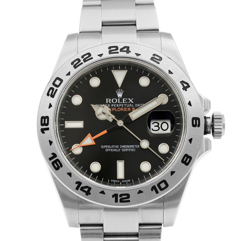 This pre-owned Rolex Explorer II 216570 is a beautiful men's timepiece that is powered by mechanical (automatic) movement which is cased in a stainless steel case. It has a round shape face, gmt, date indicator dial and has hand sticks & dots style