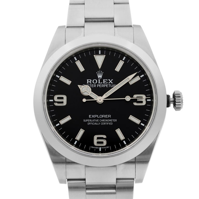 This pre-owned Rolex Explorer 214270 is a beautiful men's timepiece that is powered by mechanical (automatic) movement which is cased in a stainless steel case. It has a round shape face, no features dial and has sticks and arabic numerals style