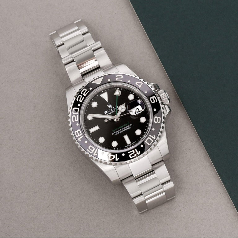 Xupes Reference: W007862 Manufacturer: Rolex Model: GMT-Master II Model Variant: 0 Model Number: 116710LN Age: 2020 Gender: Men Complete With: Rolex Box, Guarantee Manual, Swing Tag & Open Guarantee Card Dial: Black Other Glass: Sapphire