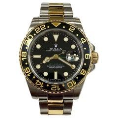 Rolex GMT Master II 116713 Black Ceramic 18 Karat Yellow Gold Stainless Steel