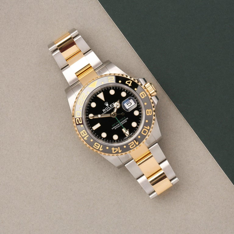 Xupes Reference: COM002709 Manufacturer: Rolex Model: GMT-Master II Model Variant: 0 Model Number: 116713LN Age: 16-02-2019 Gender: Men Complete With: Rolex Box, Manuals, Card Holder, Swing Tags & Guarantee  Dial: Black Baton  Glass: Sapphire