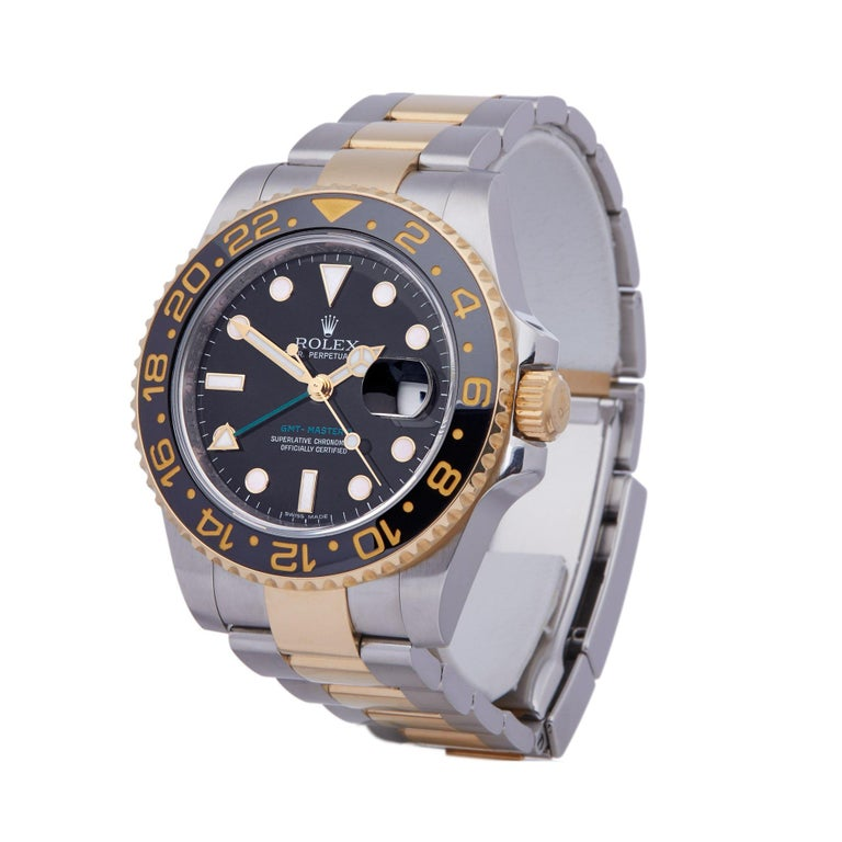 Xupes Reference: COM002463 Manufacturer: Rolex Model: GMT-Master II Model Variant:  Model Number: 116713LN Age: 07-03-2010 Gender: Men Complete With: Rolex Box, Manuals, Guarantee & Bezel Guard Dial: Black Other Glass: Sapphire Crystal Case