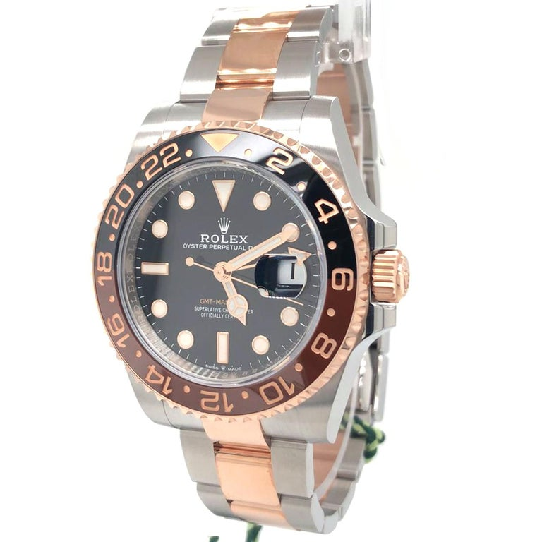 Rolex 126711 GMT-Master II 40mm Root Beer Black Dial Black/Brown Ceramic Bezel Stainless Steel and Rose Gold  Launched in 1954, the GMT Master (GMT = Greenwich Mean Time) was designed in collaboration with Pan American Airways. Having an accurate