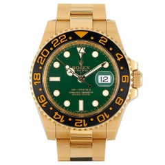 Rolex GMT-Master II 18K Yellow Gold Green Dial Watch 116718LN