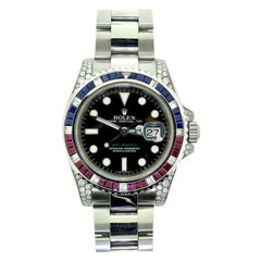 Rolex GMT Master II Ref. 116710 Sapphire, Ruby & Diamond Stainless Steel Watch