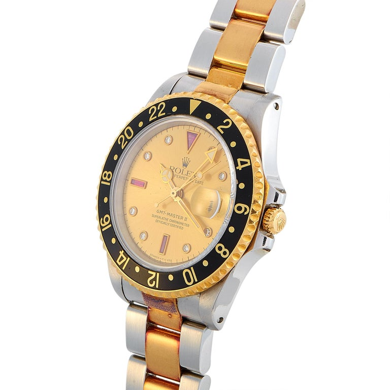 """The Rolex GMT-Master II watch, reference number 16713, is a member of the superb """"GMT-Master II"""" collection.  This model boasts a 40 mm stainless steel case that is fitted with an 18K yellow gold bezel. The case is water-resistant to 100 meters and"""