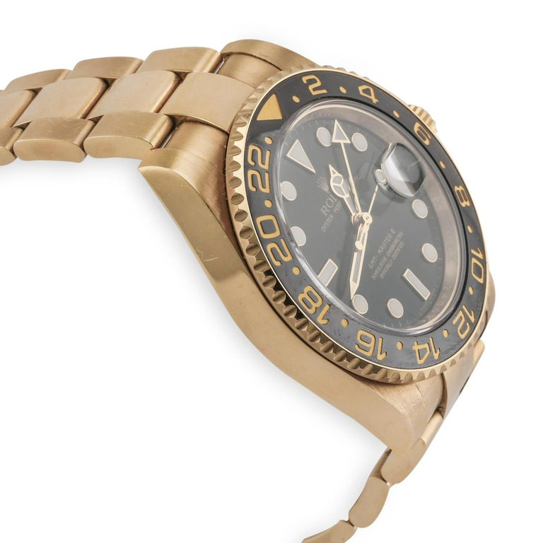 18K Yellow Gold Case Black bi-directional 24 hour bezel Functions:  Hours, minutes, seconds, date, GMT. Complications:  GMT, world time Sapphire crystal with Cyclops lens over the date Dial:  Green Bracelet:  18K Yellow Gold Oyster Bracelet with