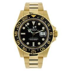 Rolex GMT Master II Yellow Gold Black Dial Watch 116718LN