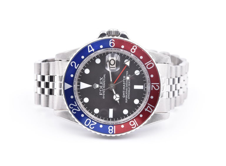Movement: automatic  Function: hours, minutes, seconds, date Case: 40mm stainless-steel case, acrylic crystal, stainless steel bezel with blue and red Pepsi insert, stainless steel screw-down crown, waterproof to 330 meters Band: stainless-steel