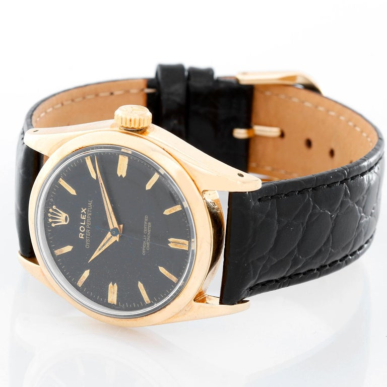Vintage Rolex Gold Shell Oyster Perpetual Men's Watch 6634 - Manual winding. 14k gold shell case with stainless steel back  (34mm diameter). Black colored dial with gold stick markers. black colored dial with gold stick markers. Pre-owned with