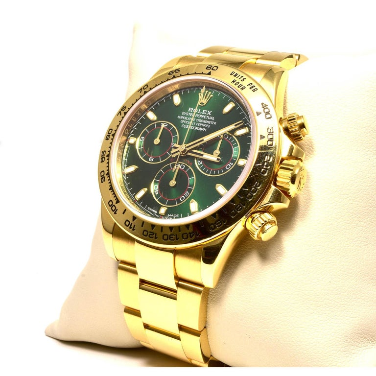 Brand: Rolex  Model: Daytona  Metal: Yellow Gold  Metal Purity: 18k  Dial: Green  Case: 40mm Yellow Gold  Bracelet: Yellow Gold Jubilee  Movement: Automatic  Accessories:  24 month Brilliance Jewels warranty Rolex Box     Details:  Beautiful Rolex