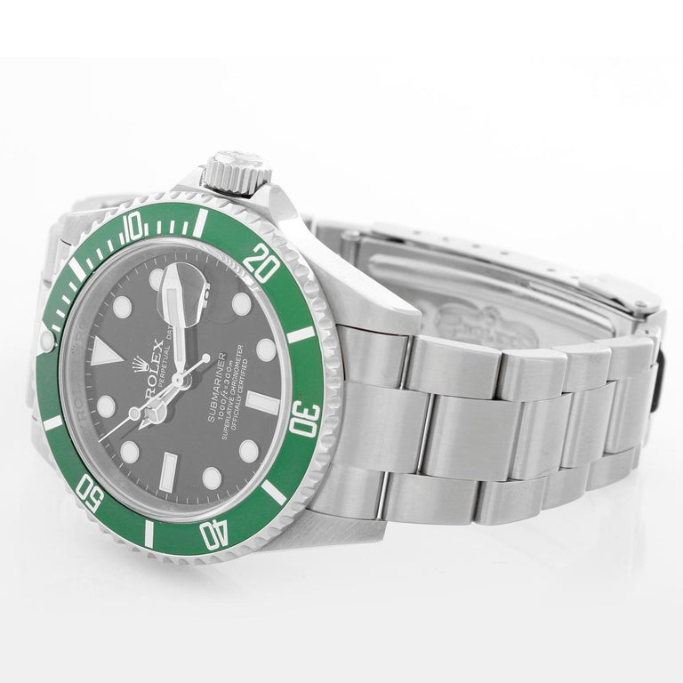 Rolex Kermit Submariner Men's  Stainless Steel Watch 16610 - Automatic winding, 31 jewels, pressure proof to 1,000 feet. Stainless steel case with time-lapse Cerachrom bezel . Black dial with luminous markers; date at 3 o'clock, green bezel.