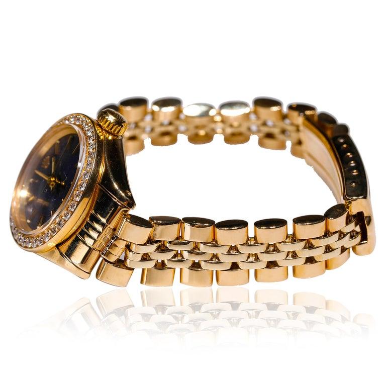 Rolex Ladies 14k Yellow Gold Jubilee Custom Diamond Dial Automatic WristWatch  SKU: WA00038  PRIMARY DETAILS Brand:  Rolex Model: ROLEX 14k YELLOW GOLD LADIES Country of Origin: Switzerland Movement Type: Automatic Year of Manufacture: