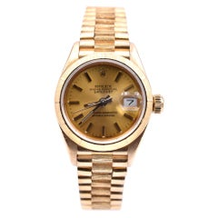 Rolex Ladies 18 Karat Gold Datejust with Engine Turned Bezel Watch Ref. 69178