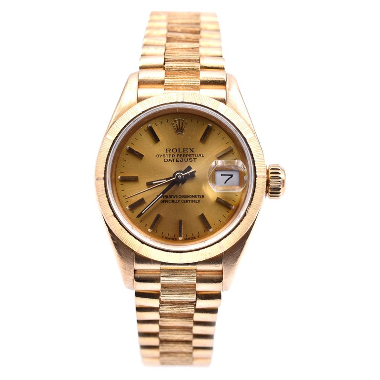 Rolex Ladies 18 Karat Gold Datejust with Engine Turned Bezel Watch Ref. 69178 For Sale