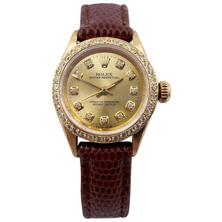 Rolex Ladies 6619 Oyster Perpetual Diamond Bezel Diamond Dial 18 Karat Gold For Sale