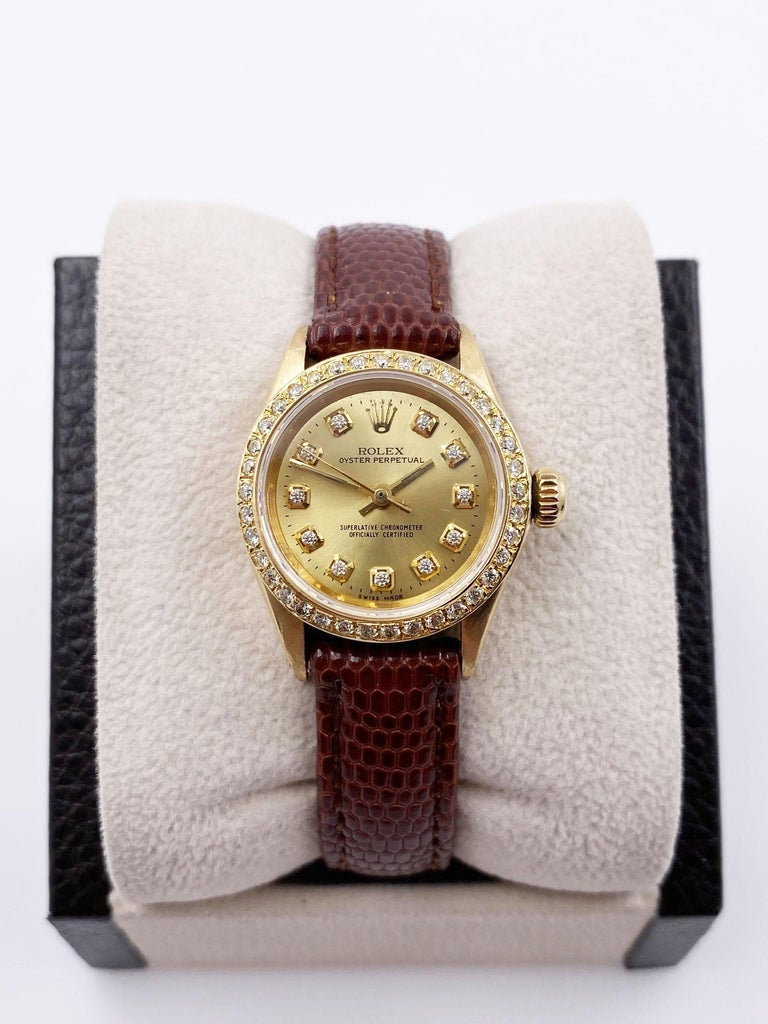Style Number: 6619     Serial: 1525***     Model: Oyster Perpetual      Case Material: 18K Yellow Gold     Band: Custom Leather Band      Bezel:  Custom Diamond Bezel      Dial: Custom Diamond Dial      Face: Sapphire Crystal      Case Size: 24mm