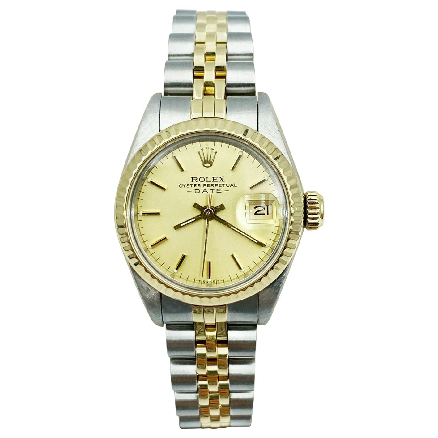 Rolex Ladies Date 69173 Champagne Dial 18 Karat Yellow Gold Stainless Steel