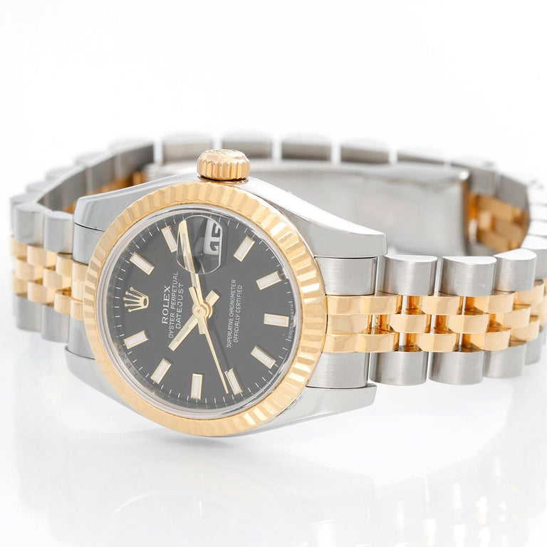 Rolex Ladies Datejust 2-Tone Jubilee Watch 179173 - Automatic winding, Quickset, 31 jewels, sapphire crystal. Stainless steel case with 18k yellow gold fluted bezel . Black dial with raised luminous hour markers . Stainless steel and 18k yellow gold