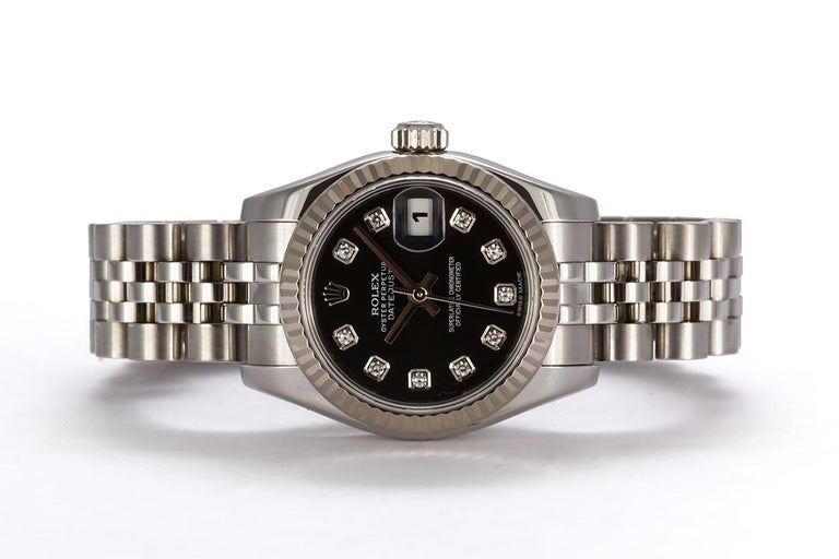 We are pleased to offer this 2015 Stainless Steel 26mm Ladies Rolex Datejust 179174. It is all original Rolex and features an 18k white gold fluted bezel, black 10 diamond dial, stainless steel jubilee bracelet and Rolex automatic movement. It comes