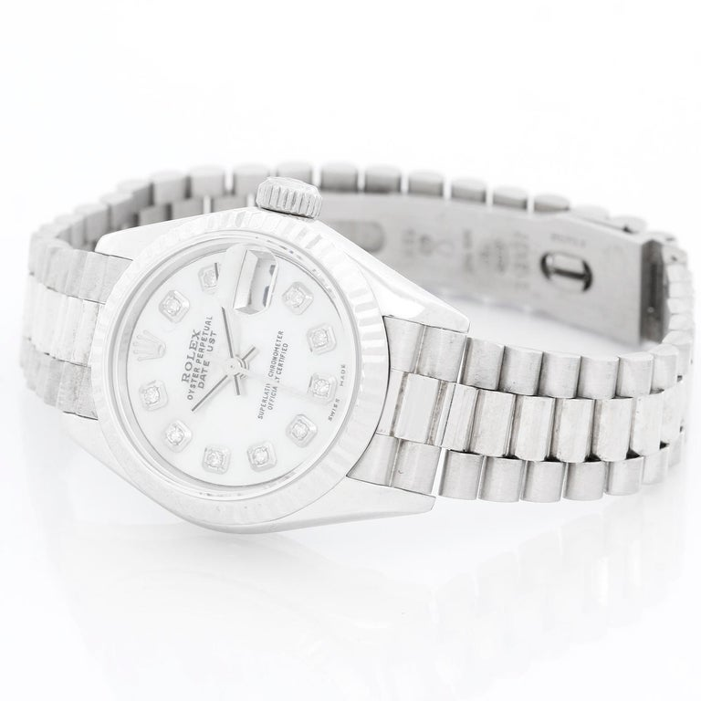 Rolex Ladies Datejust 69139 President Bracelet  - Automatic winding. 18k white gold case  ( 26 mm ) . Custom Mother of Pearl Diamond dial . 18k white gold hidden clasp President bracelet. Pre-owned with box .