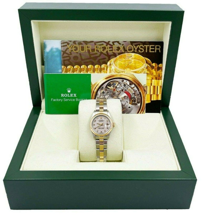 Style Number: 69173     Serial: U138***     Model: Datejust      Case Material: Stainless Steel     Band: 18K Yellow Gold & Stainless Steel      Bezel:  18K Yellow Gold     Dial: Ivory Jubilee Dial     Face: Sapphire Crystal      Case Size: 26mm