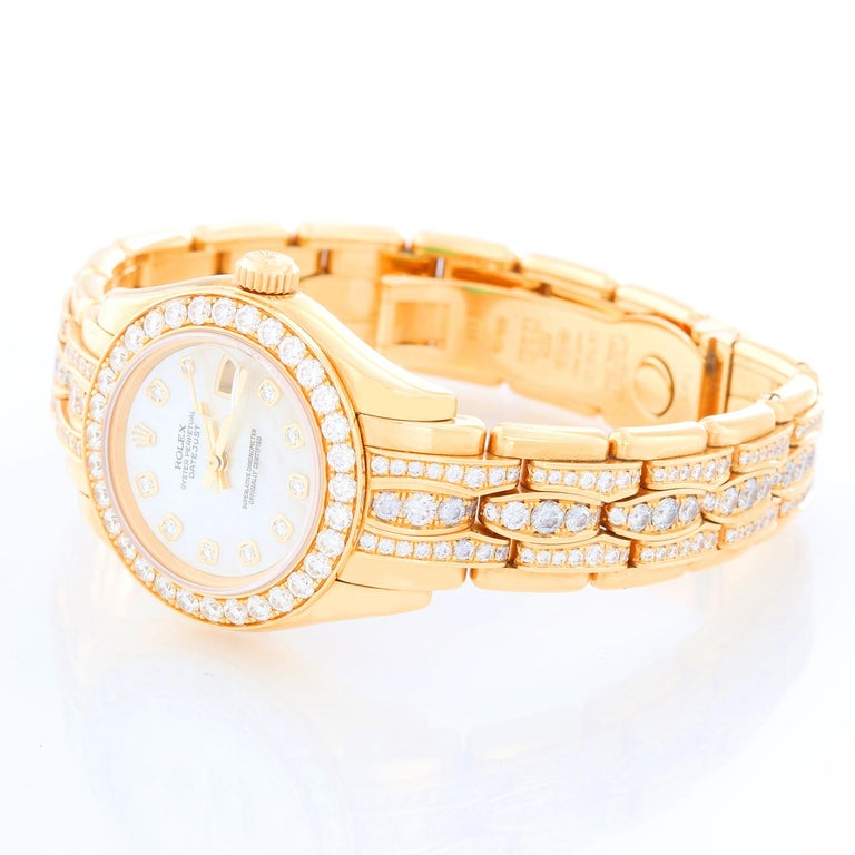 Rolex Ladies Masterpiece/Pearlmaster Gold Mother of Pearl Diamond Watch 80298/ 69298 - Automatic winding, 31 jewels, Quickset, sapphire crystal. 18k yellow gold case with factory 32 diamond bezel (29mm diameter). Genuine Rolex Mother-of-Pearl dial