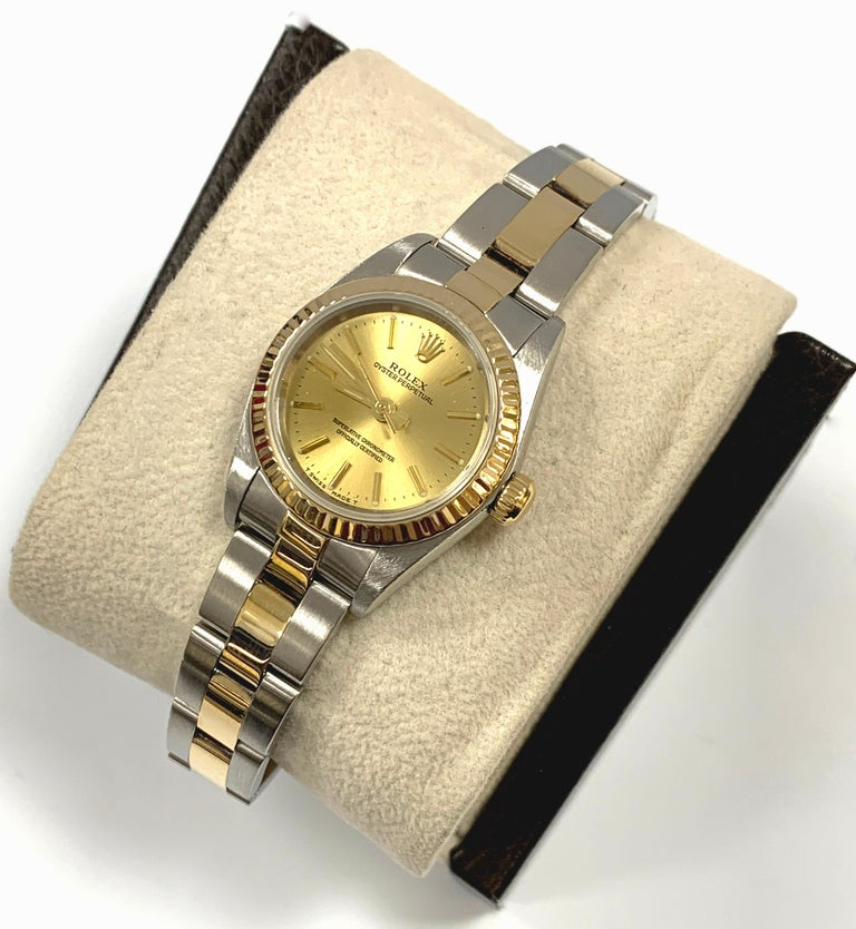 Style Number: 76193     Serial: A470***   Year: 2000     Model:  Ladies Oyster Perpetual      Case Material: Stainless Steel      Band: 18K Yellow Gold, Stainless Steel      Bezel:  18K Yellow Gold, Fluted      Dial: Champagne      Face: Sapphire
