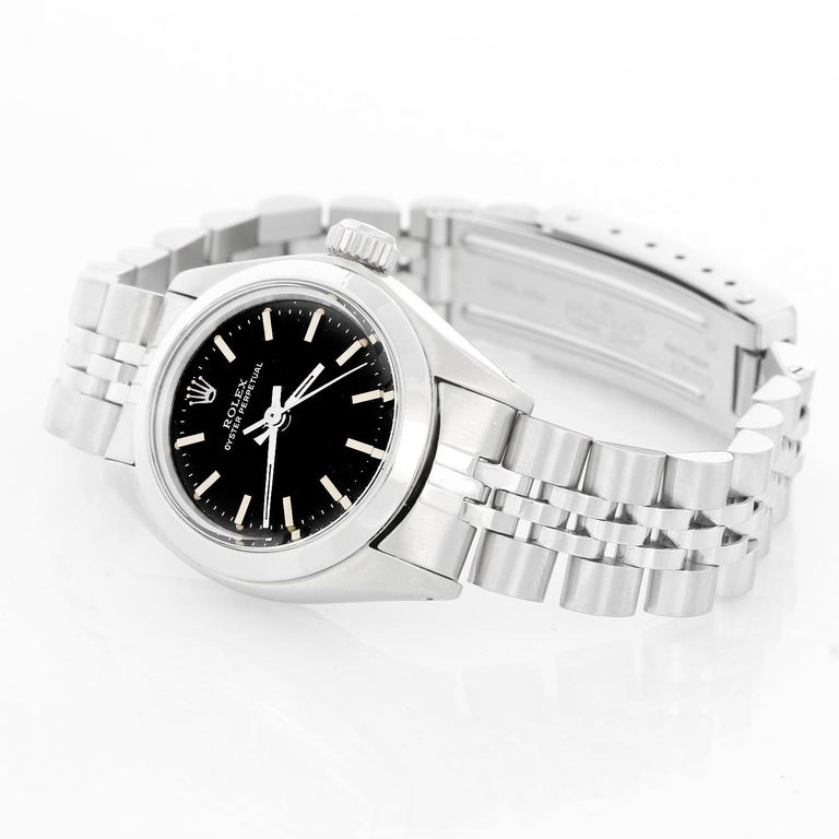 Rolex Ladies Oyster Perpetual No-Date Stainless Steel Watch 6718 - Automatic winding. Stainless steel case with smooth bezel (26 mm ). Black dial with stick markers. Stainless steel Jubilee bracelet. Pre-owned with custom box.
