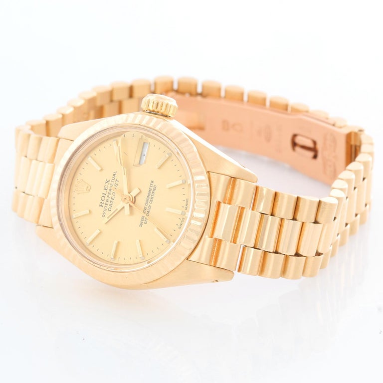 Rolex Ladies President 18K Yellow Gold 6917 Watch - Automatic winding, 29 jewels, Quickset date, sapphire crystal. 18k yellow gold case with fluted bezel (26mm diameter). Champagne dial . 18k yellow gold hidden-clasp President bracelet. Pre-owned