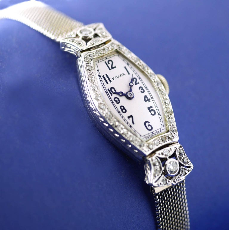 "A rare Art Deco diamond wristwatch by Rolex made in 1926 .  The 18 carat white gold case is set with diamonds, chased detail on the sides, marked on the inside case back with ""7 World's Records"
