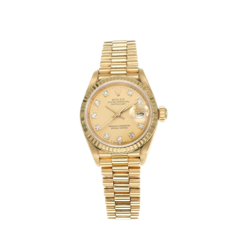 Rolex lady's 18k yellow gold Datejust with factory diamond dial, Ref. 69178, circa 1987.  10 round diamonds 18k yellow gold  74.8 grams Length: 6.75 inches Width without crown: 26mm Width with crown: 28.58mm Band width at case: 13mm Case thickness: