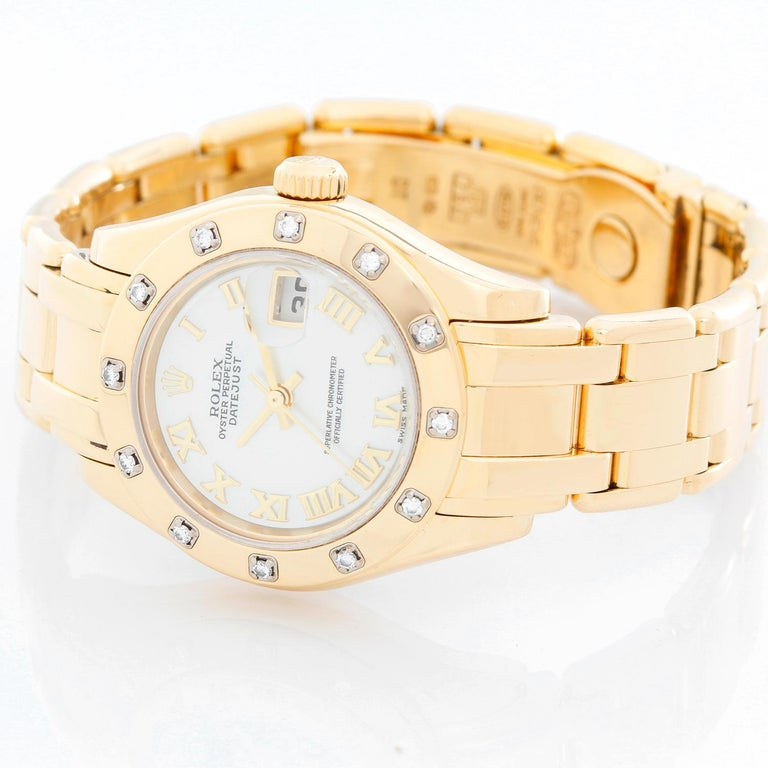 Rolex Lady Datejust Pearlmaster 18k Yellow Gold Ladies Diamond Watch 80318 - Automatic winding, 31 jewels, Quickset, sapphire crystal. 18k yellow gold case with factory 12 diamond bezel (29mm diameter). Genuine Rolex Mother of Pearl dial with Roman