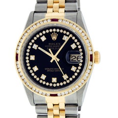 Rolex Men's Datejust S/S and 18 Karat Yellow Gold Black Diamond Dial Ruby