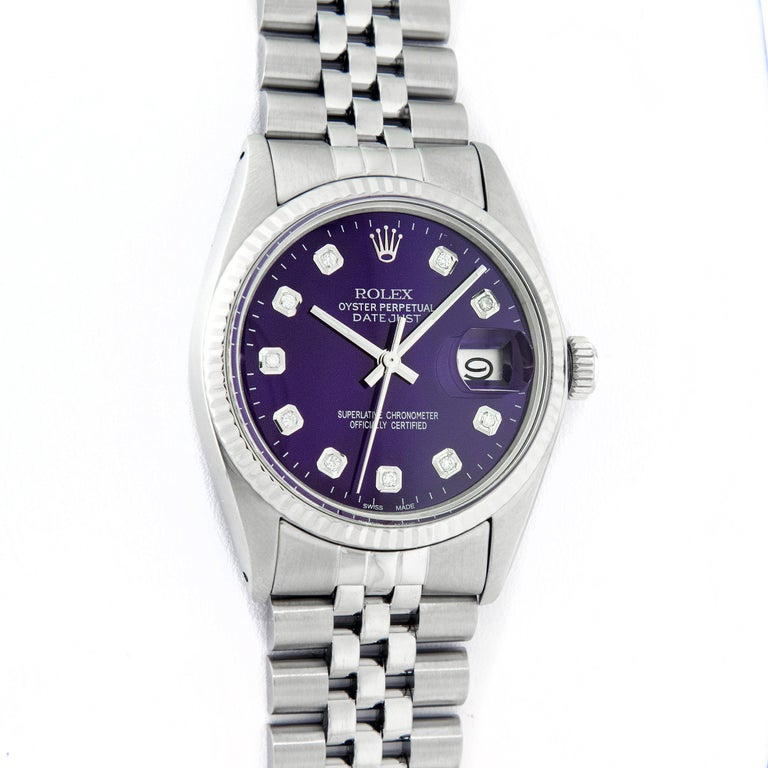 WATCH DESCRIPTION   BRAND : Rolex MODEL : Datejust CASE SIZE : 36mm GENDER : Men's CASE : Rolex Stainless Steel Case  WATCH FEATURES   DIAL : Rolex Custom Refinished Purple Diamond Dial BEZEL : White Gold Fluted Bezel CRYSTAL : Custom Plastic