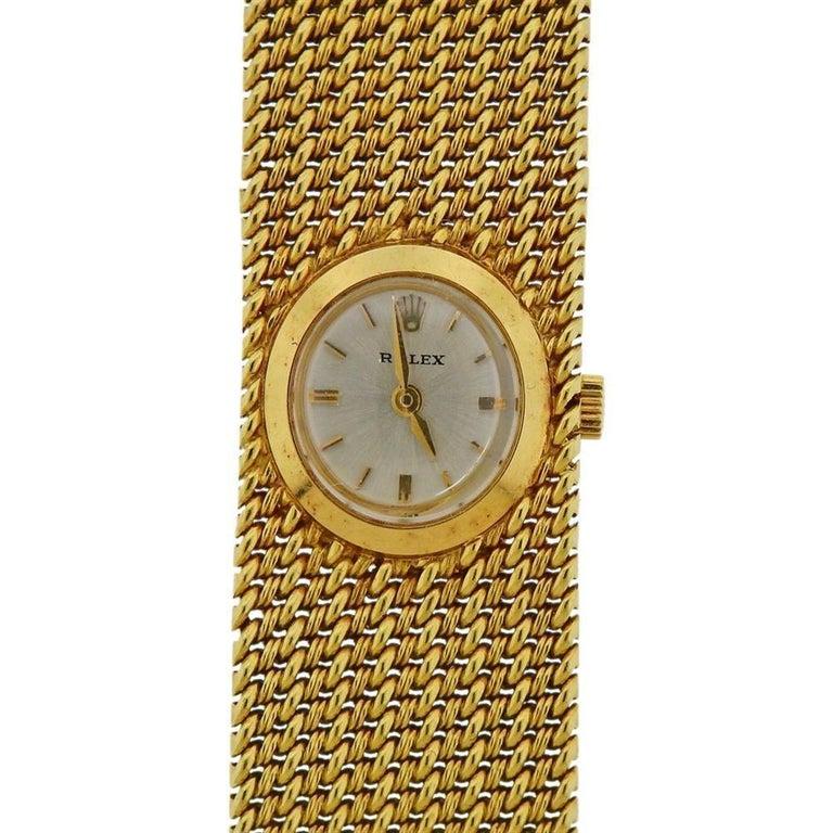Mid century, circa 1950s, 18k gold Rolex bracelet watch. Bracelet is 6.5