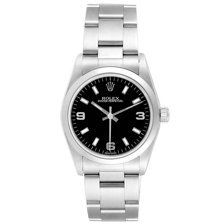 Rolex Midsize 31 Black Dial Domed Bezel Steel Ladies Watch 77080. Officially certified chronometer self-winding movement. Stainless steel oyster case 31.0 mm in diameter. Rolex logo on a crown. Stainless steel smooth bezel. Scratch resistant