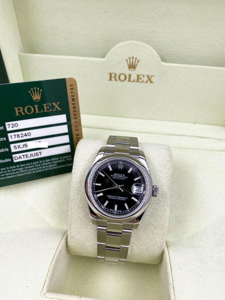 Style Number: 178240     Serial: 5XJ50***   Year: 2011     Model: Datejust     Case Material: Stainless Steel     Band: Stainless Steel     Bezel:  Stainless Steel     Dial: Black     Face: Sapphire Crystal     Case Size: 31mm     Includes:   -Rolex