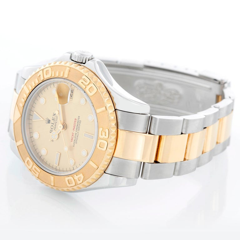 Rolex Midsize Yacht-Master 35mm Steel & Gold Men's or Ladies Watch 168623 - Automatic winding; sapphire crystal. Stainless steel case with 18k yellow gold bezel . Champagne dial. Stainless steel and 18k yellow gold Oyster bracelet with flip-lock