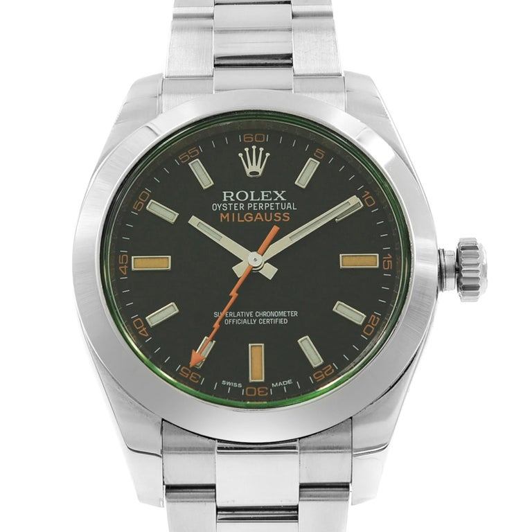 This pre-owned Rolex Milgauss  116400  is a beautiful men's timepiece that is powered by an automatic movement which is cased in a stainless steel case. It has a round shape face,  dial and has hand sticks style markers. It is completed with a
