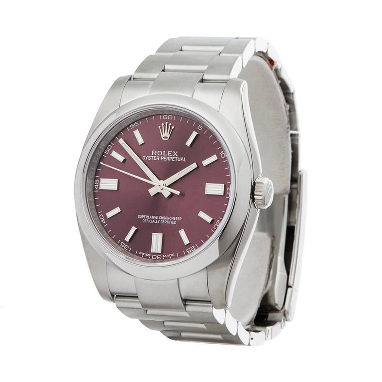 Ref: COM1625 Manufacturer: Rolex Model: Oyster Perpetual Model Ref: 116000 Age: 18th April 2018 Gender: Mens Complete With: Box & Guarantee Dial: Red Grape Baton Glass: Sapphire Crystal Movement: Automatic Water Resistance: To Manufacturers