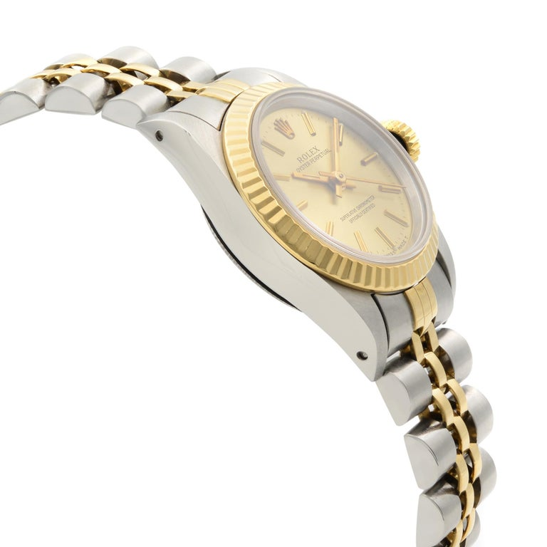 Rolex Oyster Perpetual 18k Yellow Gold Steel Champagne Dial Ladies Watch 67193 In Excellent Condition For Sale In New York, NY
