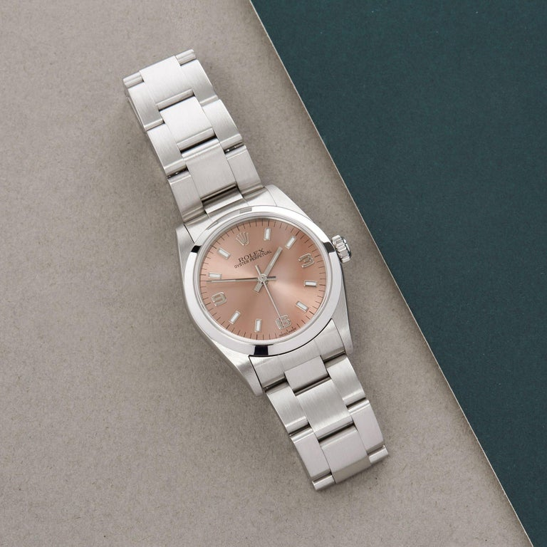 Xupes Reference: W007568 Manufacturer: Rolex Model: Oyster Perpetual Model Variant: 31 Model Number: 77080 Age: 1999 Gender: Ladies Complete With: Rolex Serivce Pouch & Swing Tag Dial: Salmon Baton Glass: Sapphire Crystal Case Size: 31mm Case