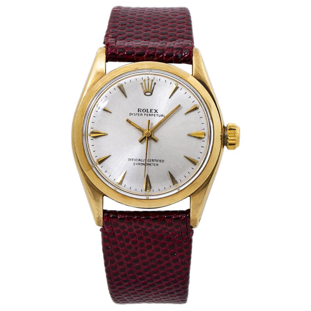 Rolex Oyster Perpetual 6048 Silver Dial 14K Yellow Gold Watch