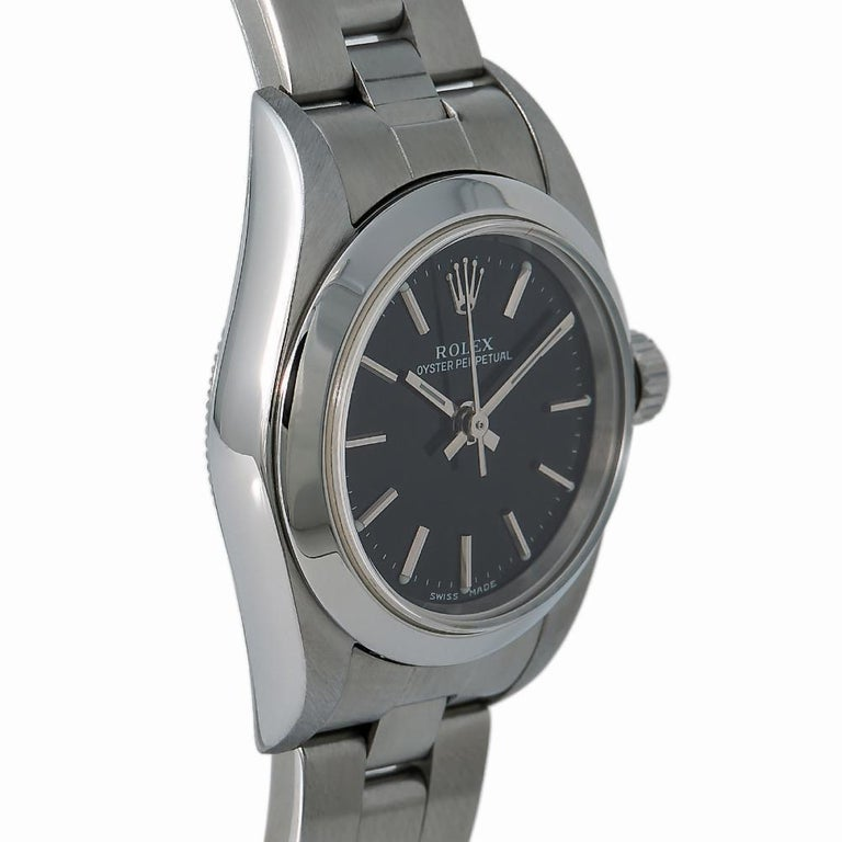 Rolex Oyster Perpetual 76080, Black Dial, Certified and Warranty In Good Condition For Sale In Miami, FL