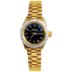 Rolex Oyster Perpetual Black Face/Diamond Bezel Rolex in 18k Yellow Gold