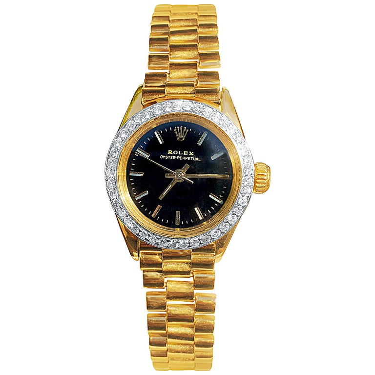 Rolex Oyster Perpetual Black Face/Diamond Bezel Rolex in 18k Yellow Gold For Sale