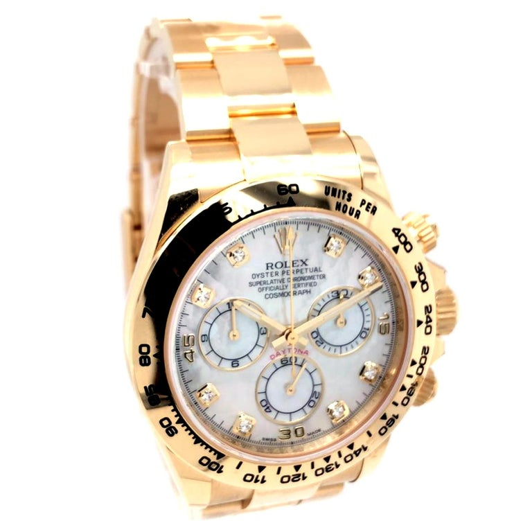 This Oyster Perpetual Cosmograph Daytona in 18 ct yellow gold, with white mother-of-pearl, diamond-set dial, and an Oyster bracelet, features an 18 ct yellow gold bezel with engraved tachymetric scale. This chronograph was designed to be the